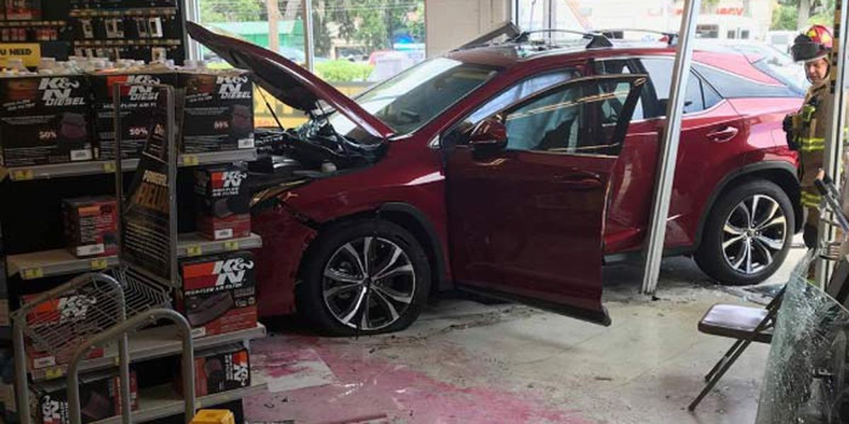 Firefighters respond after car crashes into store