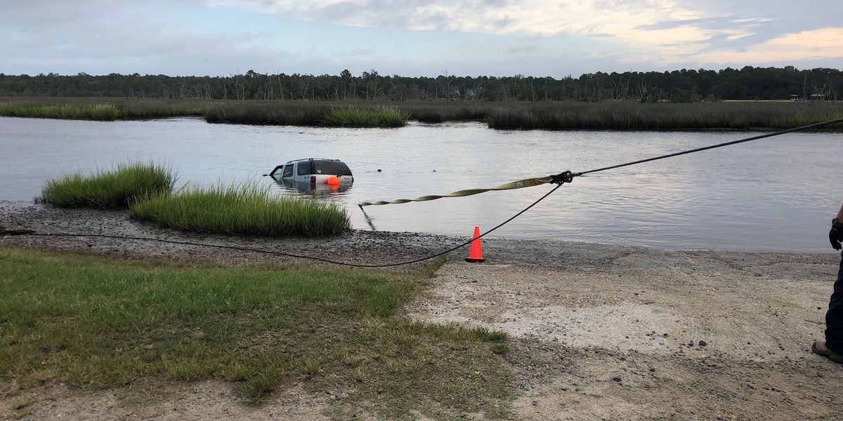 Deputies: Man drove SUV into marsh, likely escaped after chase