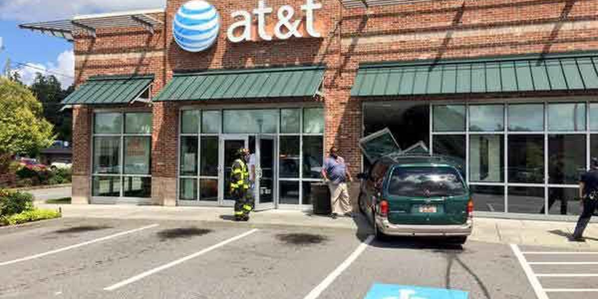 Driver okay after van crashes into W. Ashley AT&T building