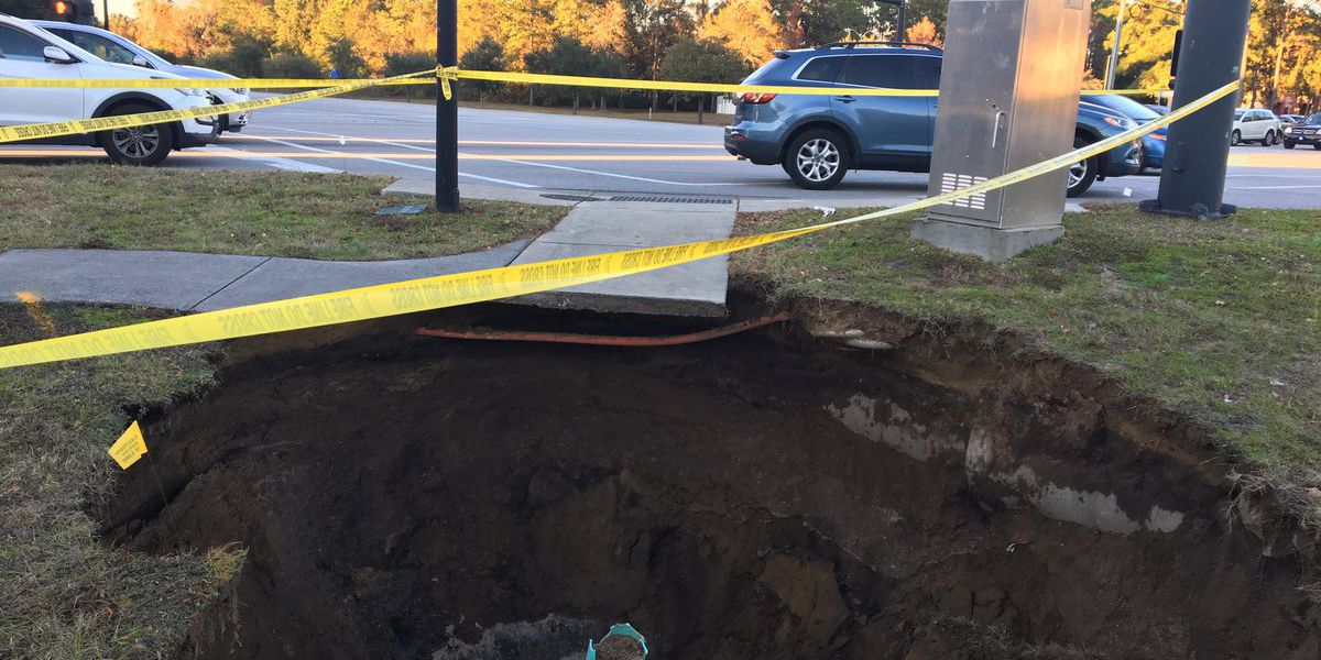Sinkhole appears on side of road on IOP Connector