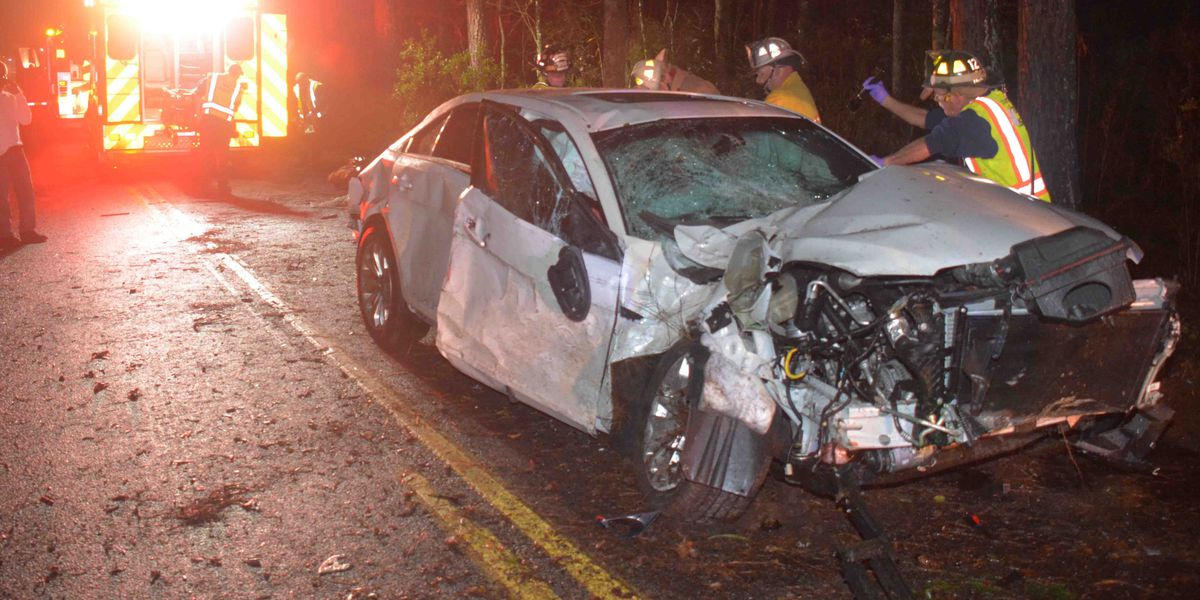 Two injured after car crashes into power pole, church sign