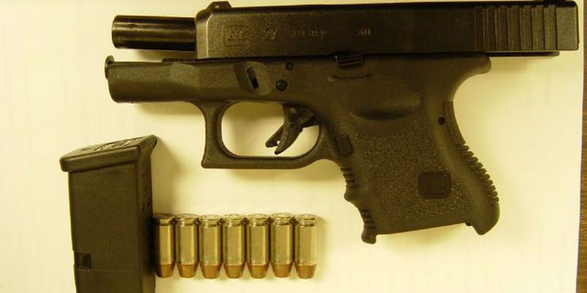 Man arrested after loaded gun found in carry-on bag at airport