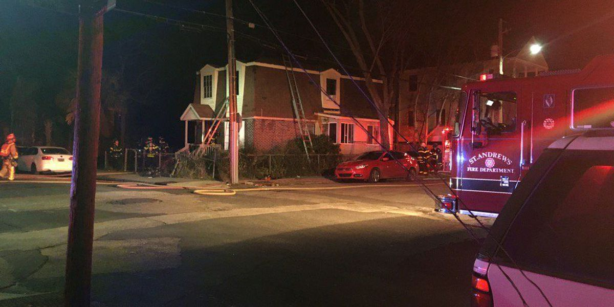 Crews extinguish house fire in downtown Charleston