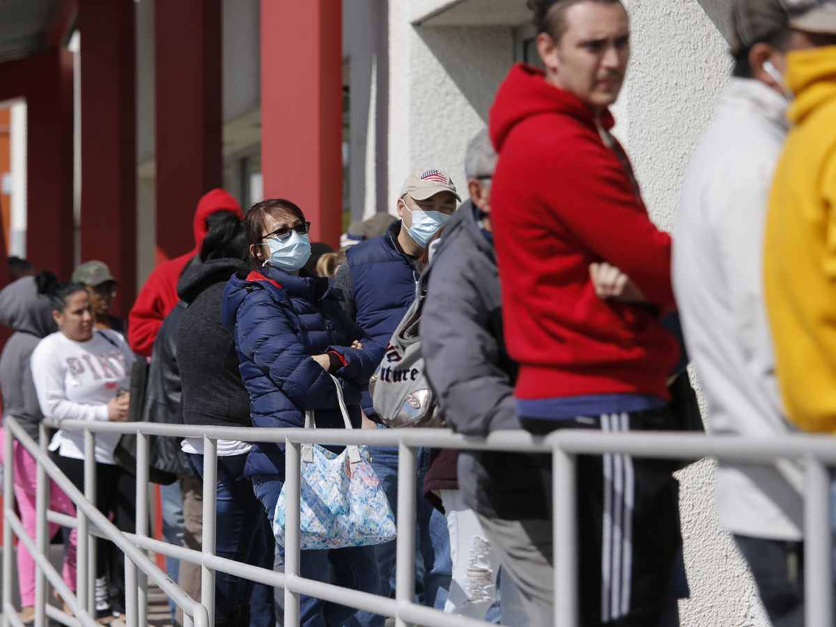 AP-NORC poll: About half of workers lose income due to virus