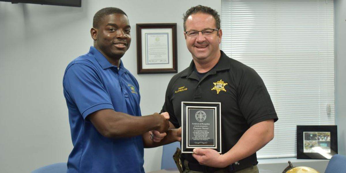 Sheriff's dispatcher honored for saving a life on the way to work