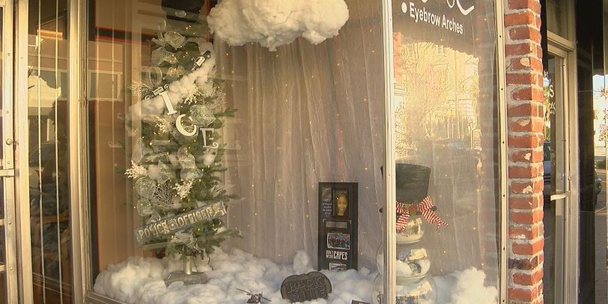 Store owner honors fallen Florence officers with window display
