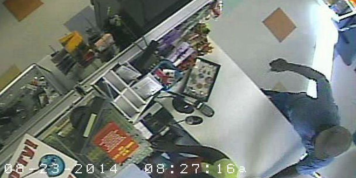 Photos released of dollar store armed robbery, stabbing suspect
