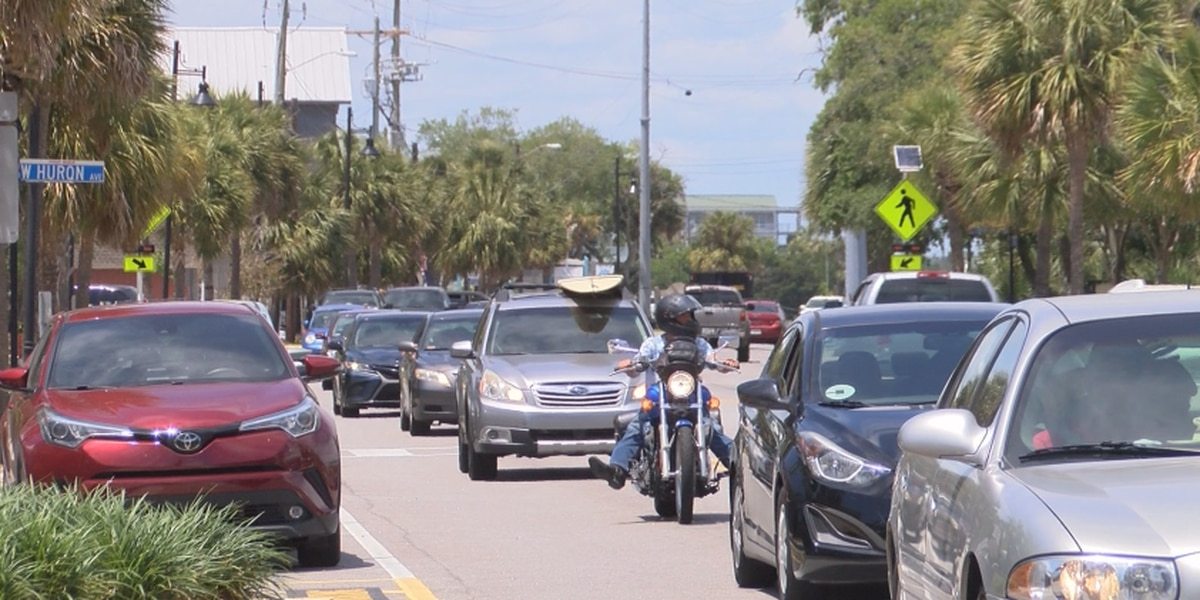 Visitors take to Folly after checkpoint lifts, businesses brace for weekend