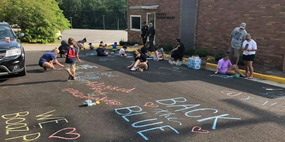 """Boaz Police Parking lot chalked in messages """"Backing The Blue"""""""