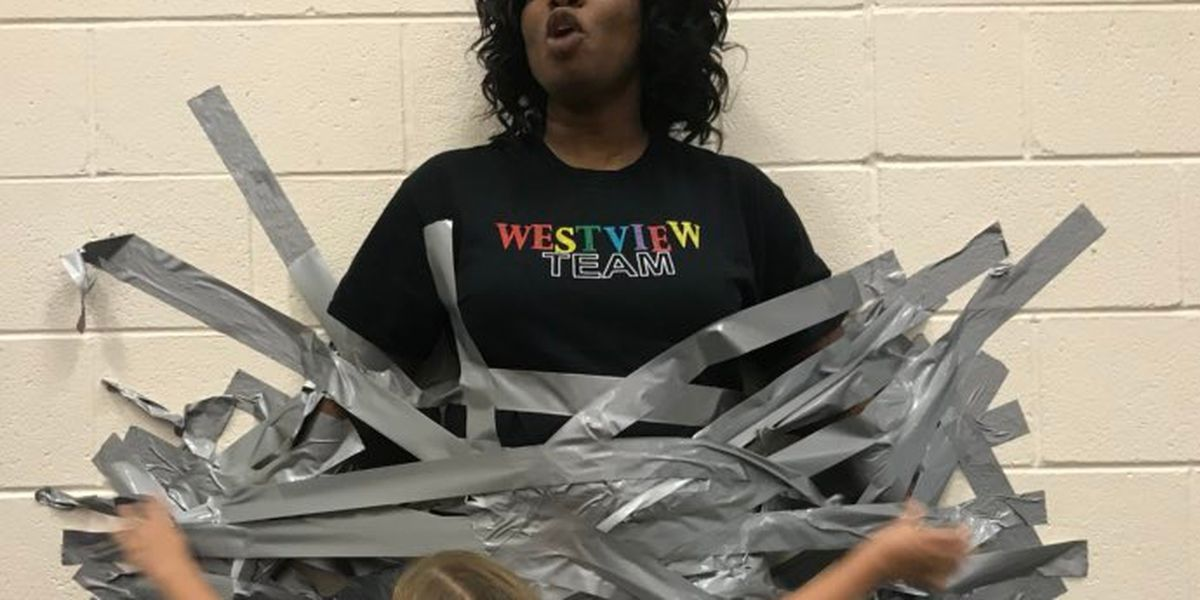 Students duct-tape principal to school wall for good cause