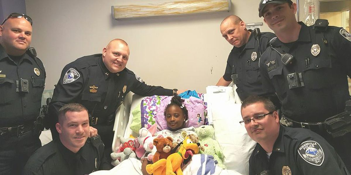 Summerville girl struck by vehicle gets special visitors, made honorary officer