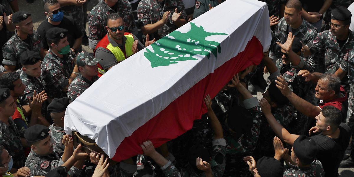 A week after blast, Beirut pauses to remember the dead