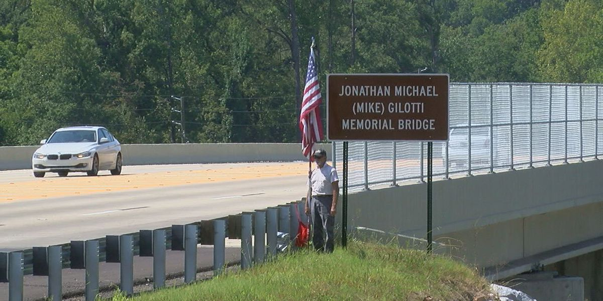 Soldier's father stands under sign to honor murdered vet in Hoover