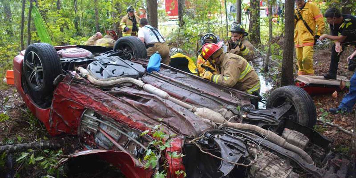 Emergency crews rescue driver trapped in car filled with water