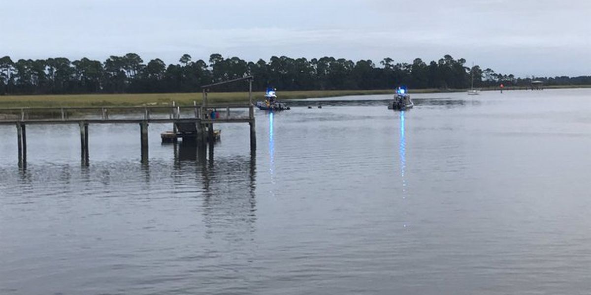 Crews working to recover car from Stono River