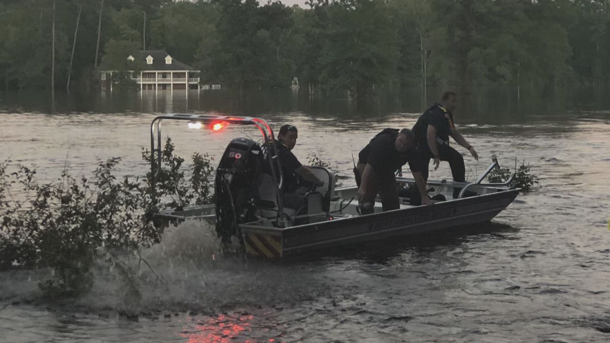 Crews searching for missing 11-year-old washed away by flood water in Florence County