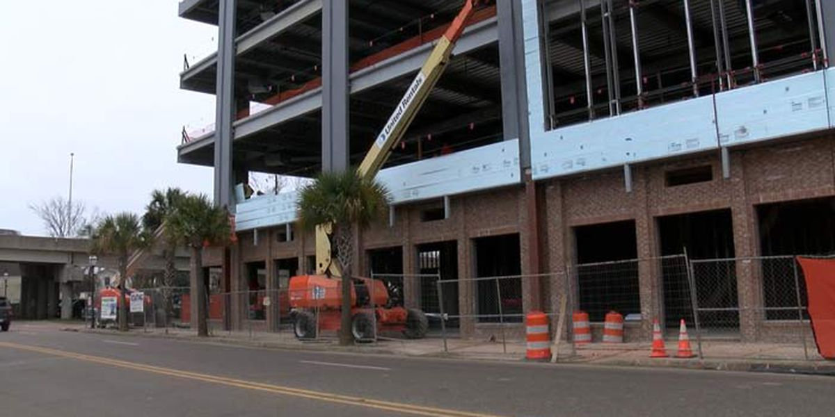 Developers seek approval for parking lot next to new downtown office building