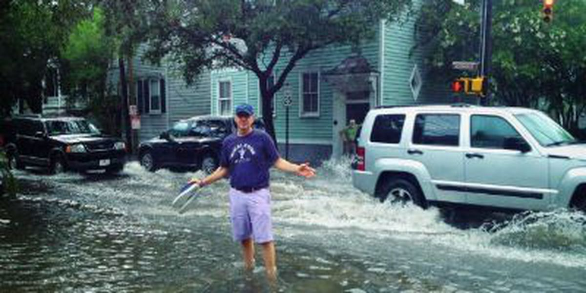 Kevin Spacey walks through flooded downtown streets