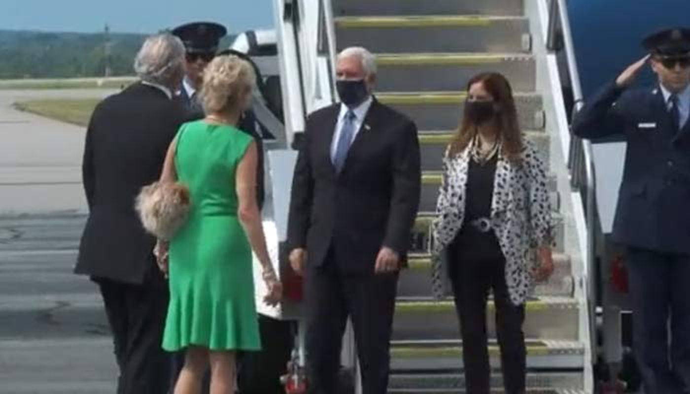 South Carolina Gov. Henry McMaster, left, and his wife, Peggy, greet Vice President Mike Pence and his wife, Karen, after the Pences arrived in Columbia Tuesday morning.