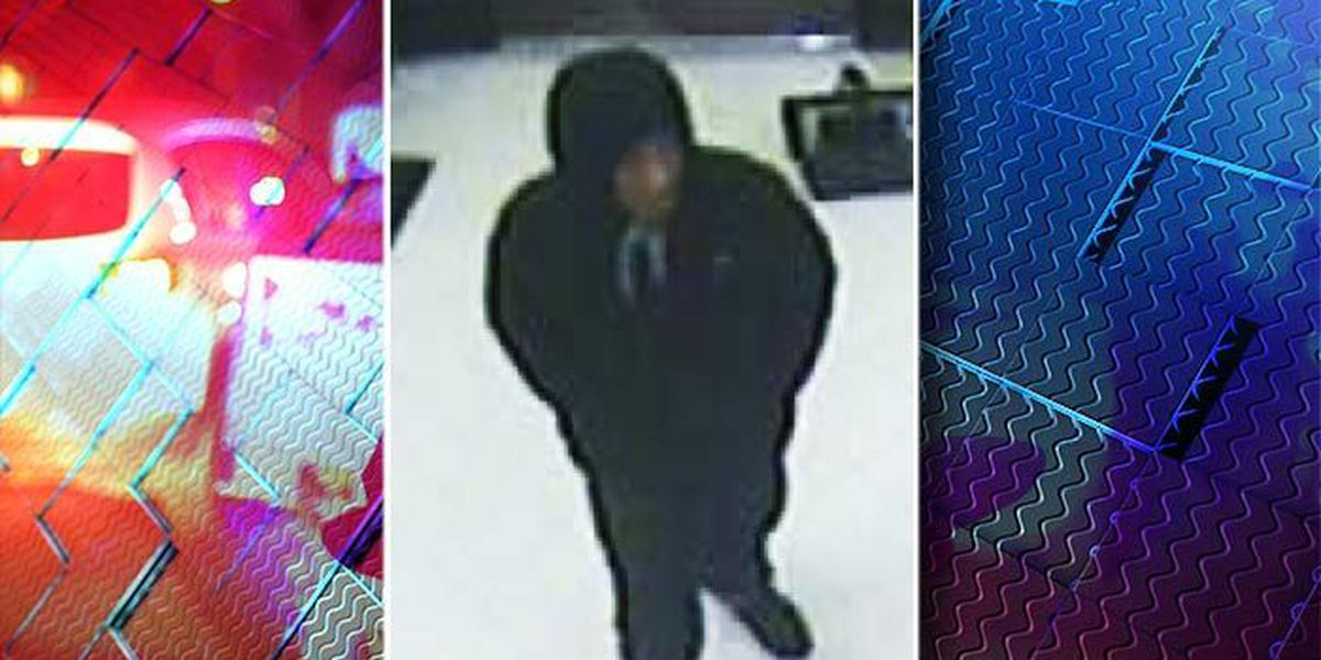 Police release surveillance images in armed robbery at grocery store