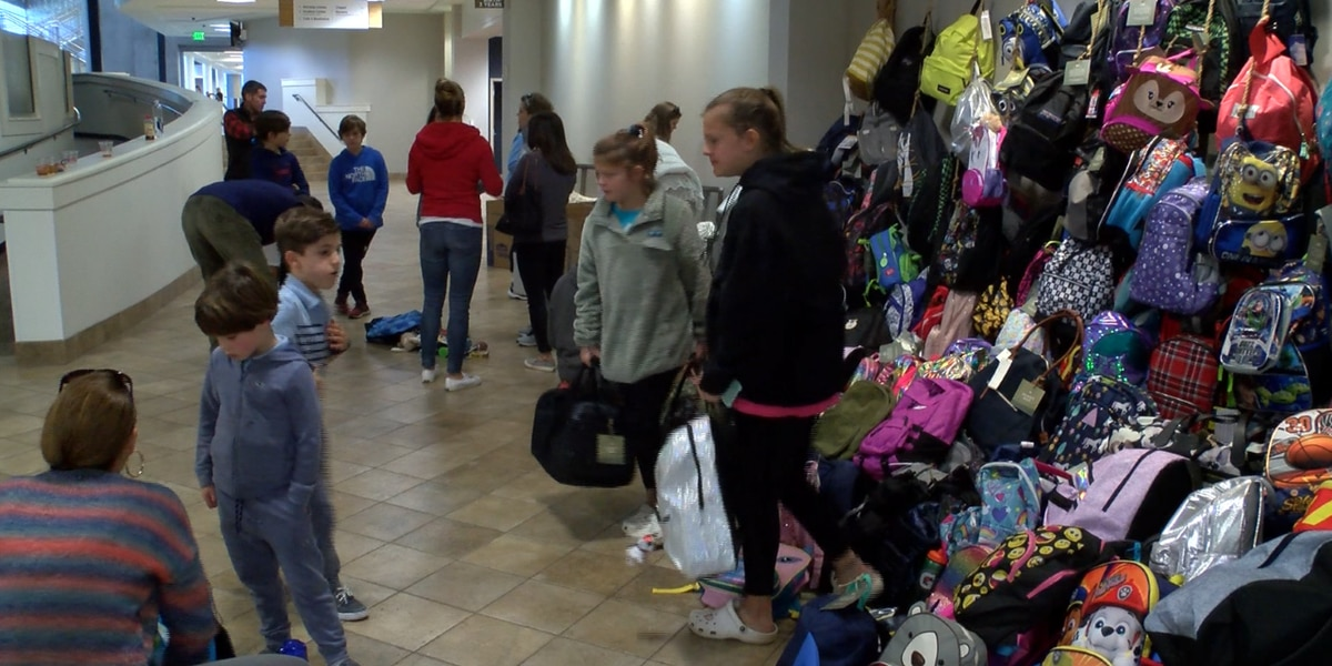 Volunteers pack more than 1,450 backpacks for children in foster care