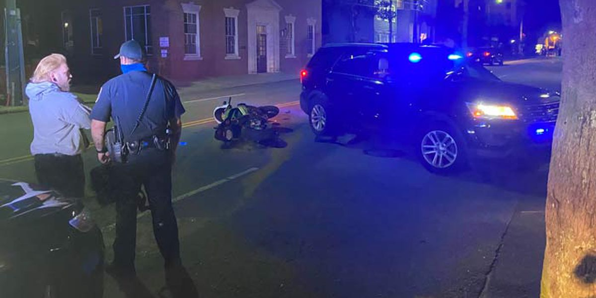 Police respond to crash involving motorcycle, vehicle near protest march
