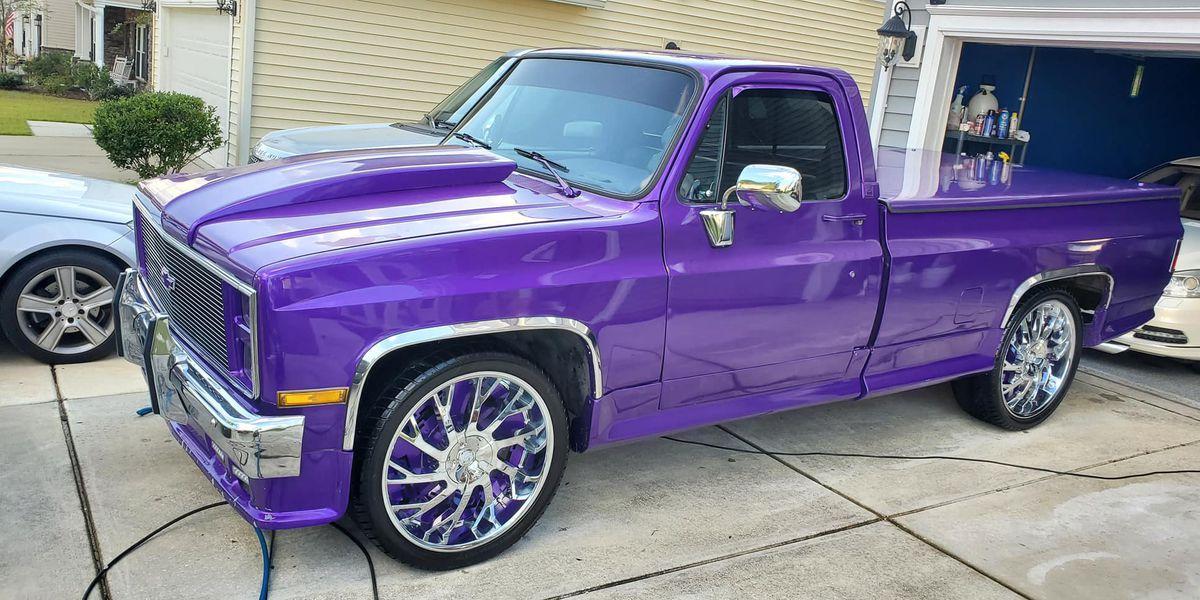 Police seek public's help in finding stolen purple truck