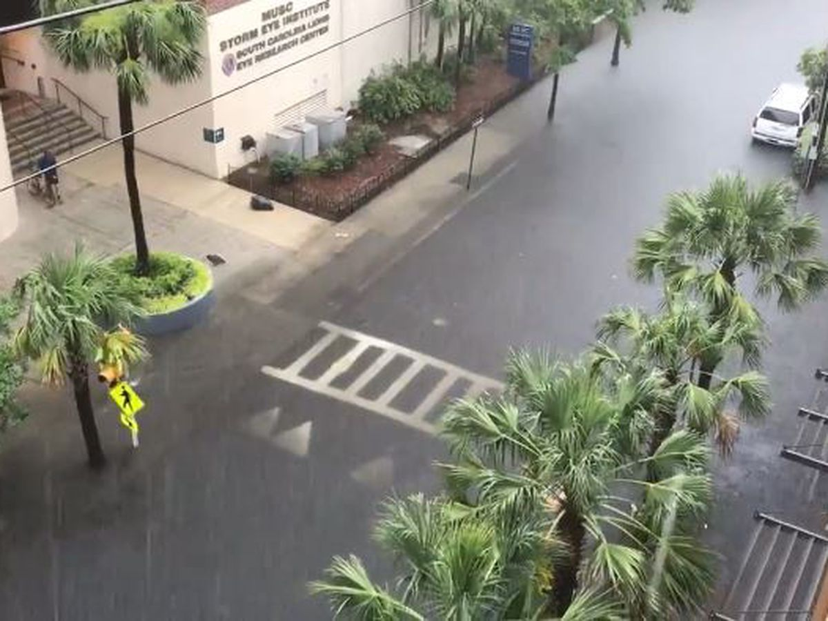 Downtown flooding subsides, police urge caution as rain continues