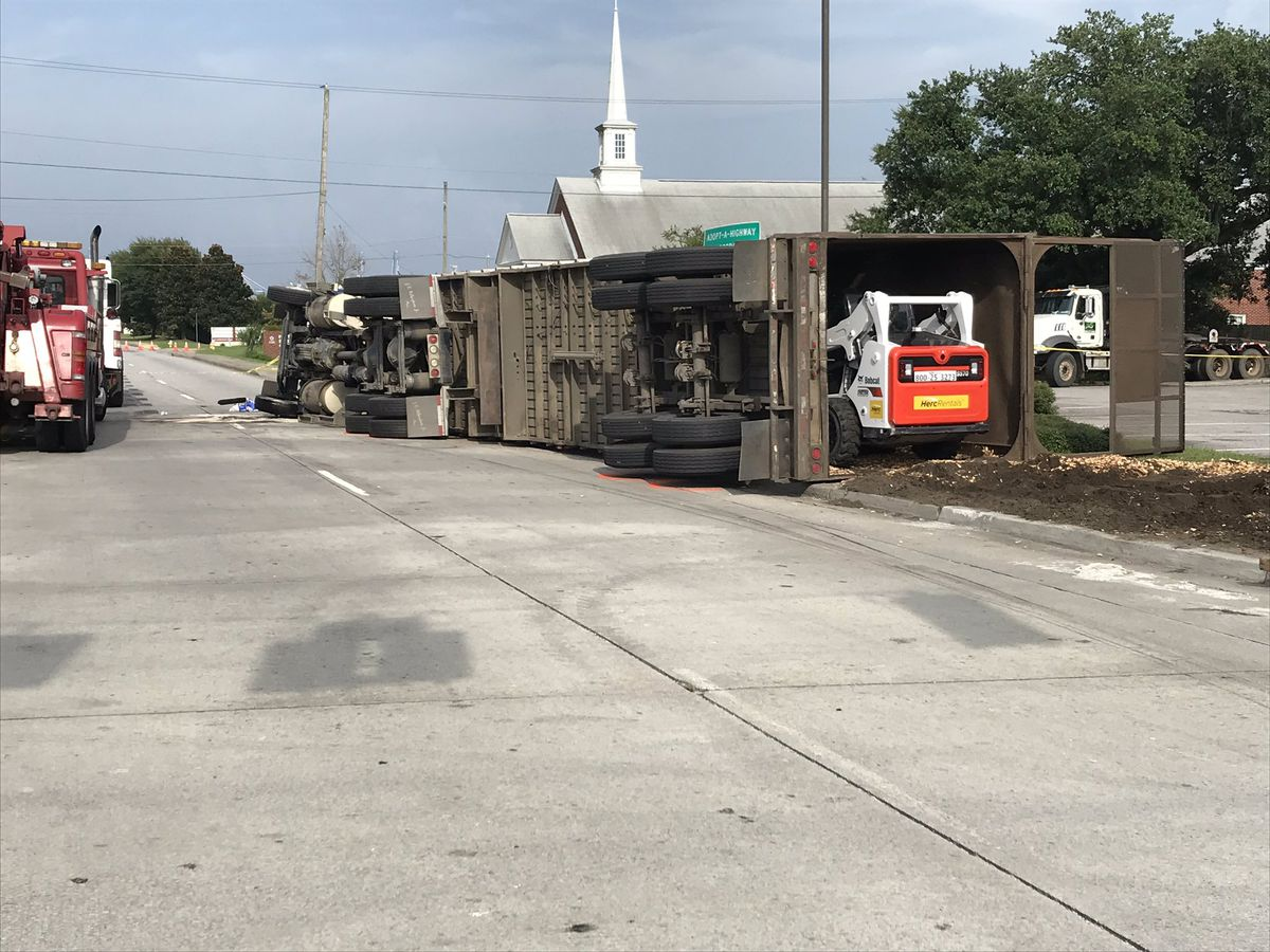 Police working tractor trailer rollover with entrapment on Remount Road