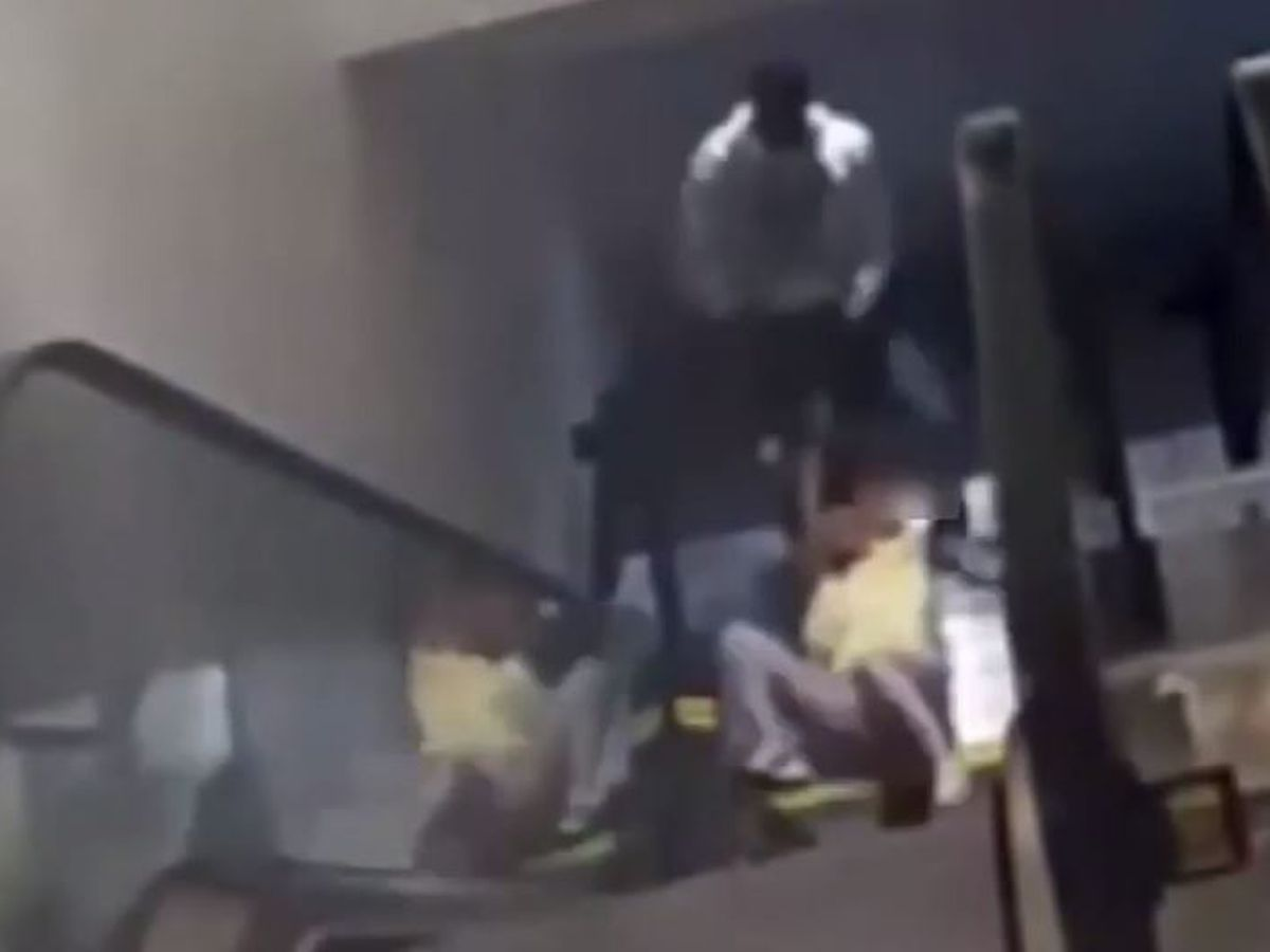 WATCH: Thief drags woman down escalator, across floor to steal purse