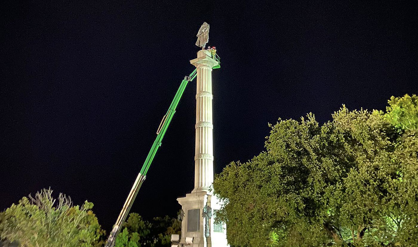 Crews in the process of removing the Calhoun statue in Marion Square in downtown Charleston.