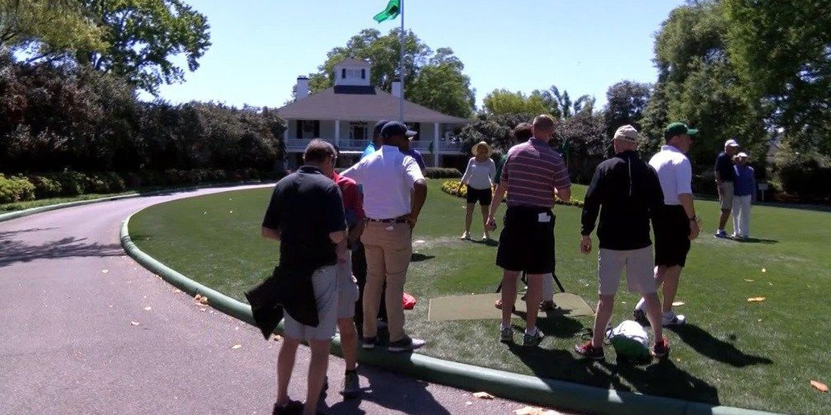 Fans purchase souvenirs as golf's Masters prepare to tee off