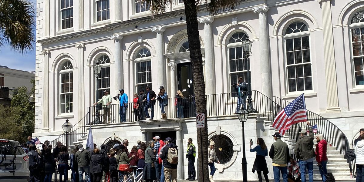 Protesters rally against city's mask ordinance