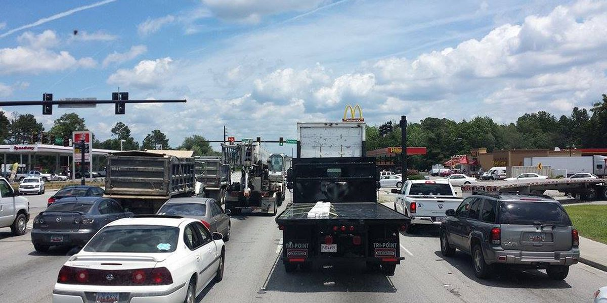 Emergency crews clear accident scene in Summerville involving motorcycle, car