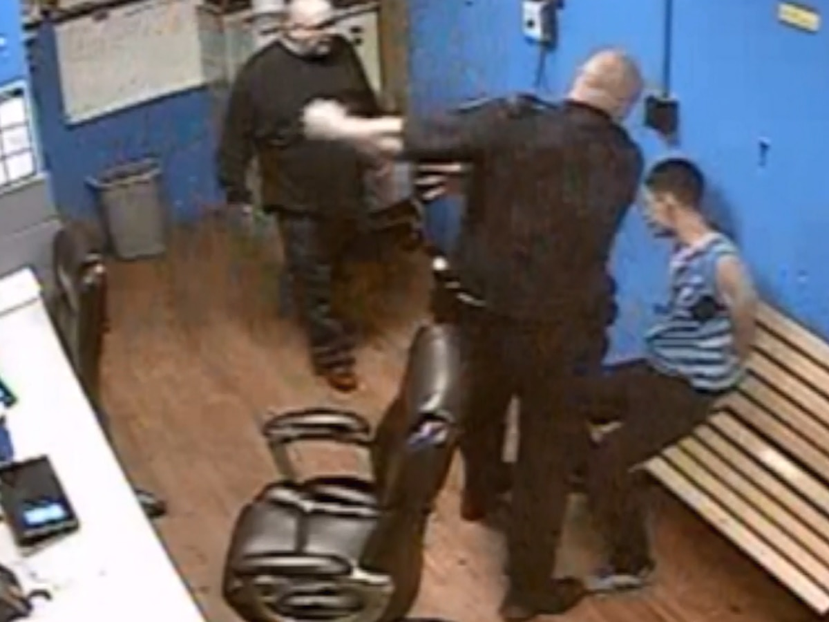 Officer charged with assault after video shows him slapping handcuffed suspect