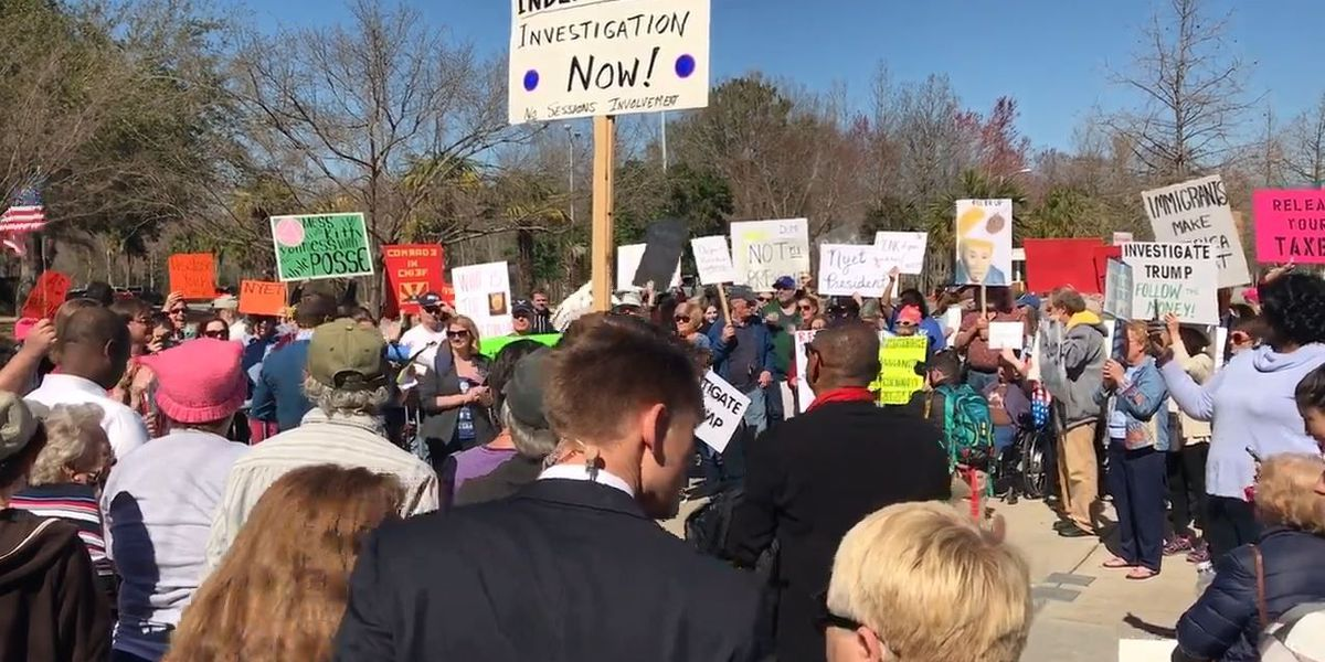 Crowd protests during President Donald Trump's stop in North Charleston