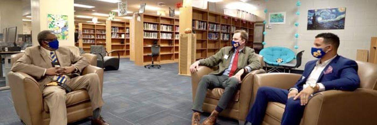 Community raises $50K+ for principal using 2nd job to help students