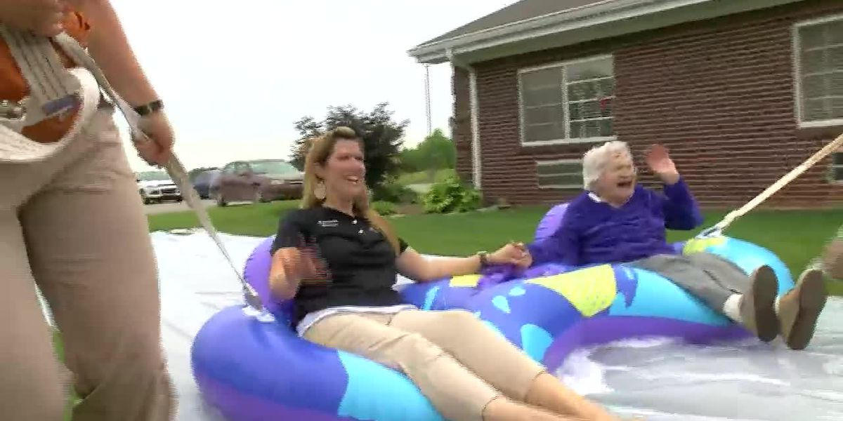 Seniors beat the heat with slip and slide at nursing home