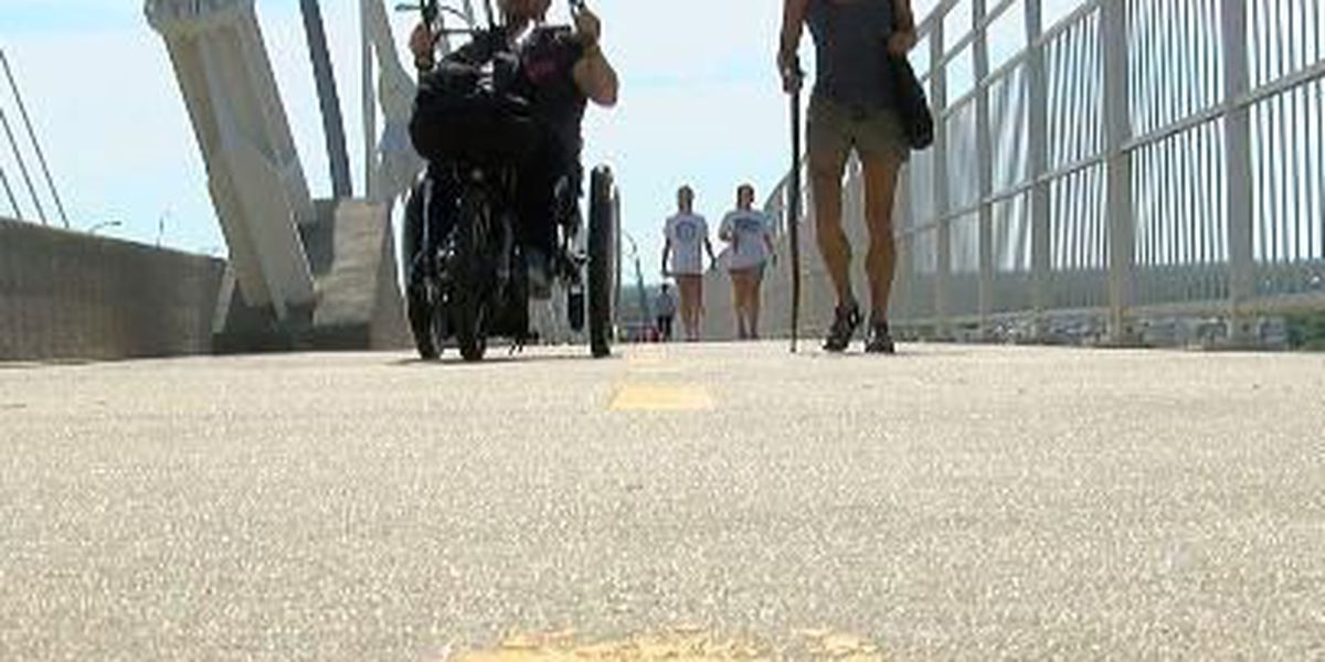 Duo with physical disabilities walking bridge to pursue dreams