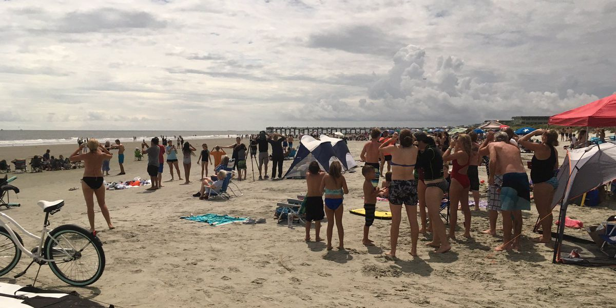 Crowds pack Isle of Palms for total eclipse