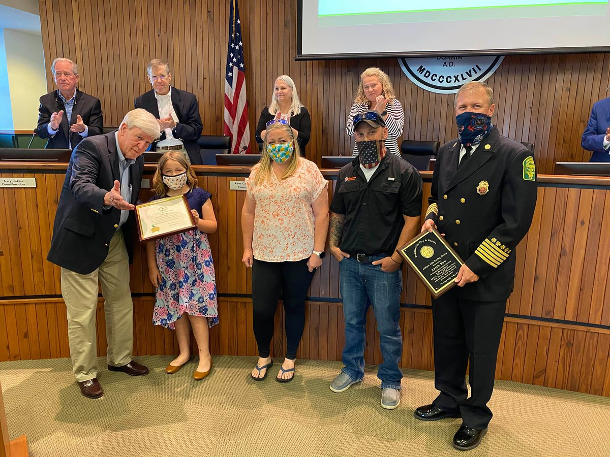 Summerville awards 9-year-old who saved family in fire