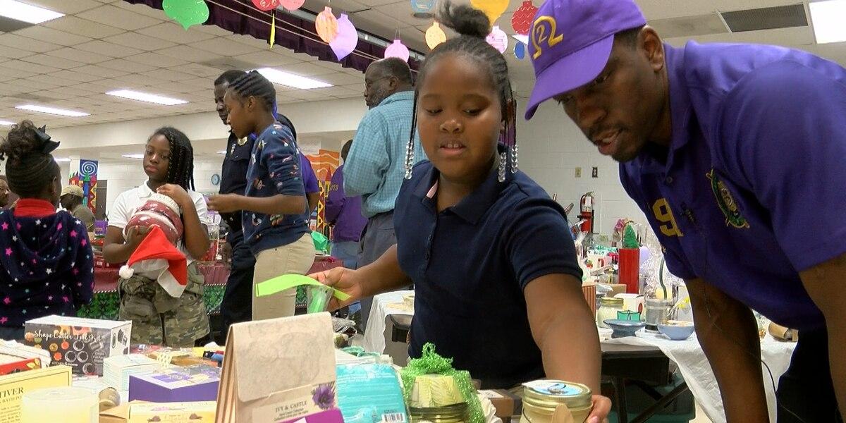 Good behavior buys holiday presents at school's holiday market