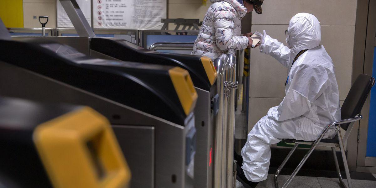 China building a hospital to treat coronavirus, expands lockdowns