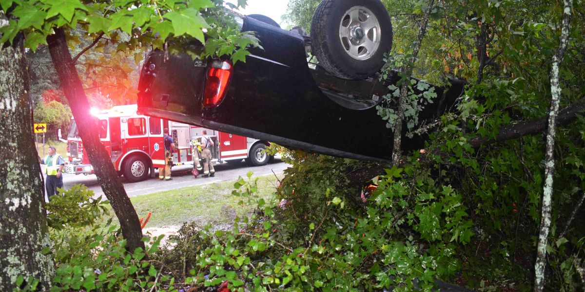 Two men injured after high speed chase ends with truck on its roof