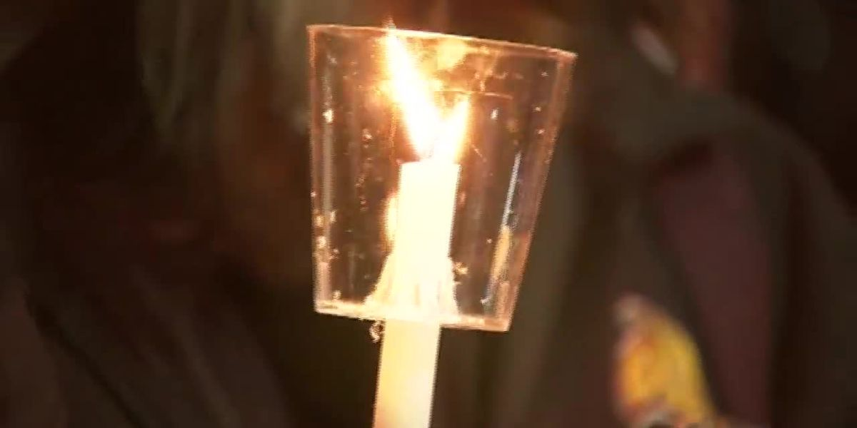 Rowan University students hold vigil after suicides