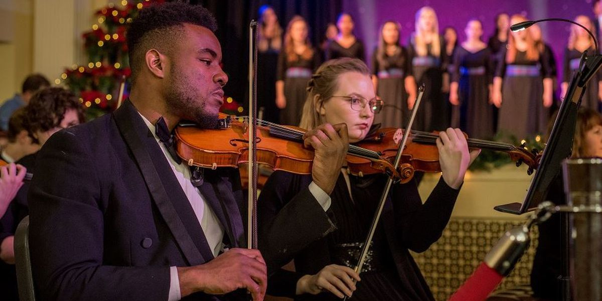 Former Cane Bay football player and violinist to serve as concertmaster in PC's annual Christmas concert