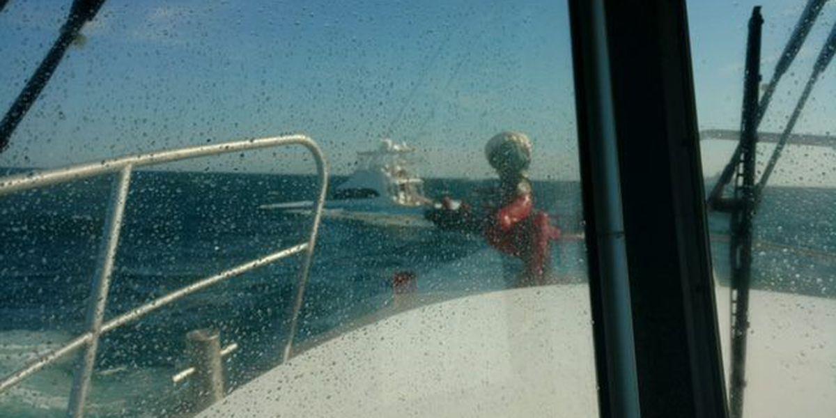 Emergency crews assist passengers of sinking boat