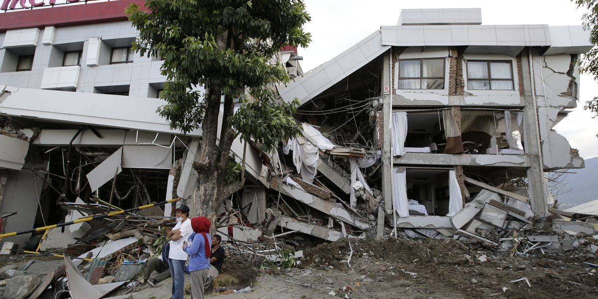 Rescuers detect possible sign of life under quake-hit hotel