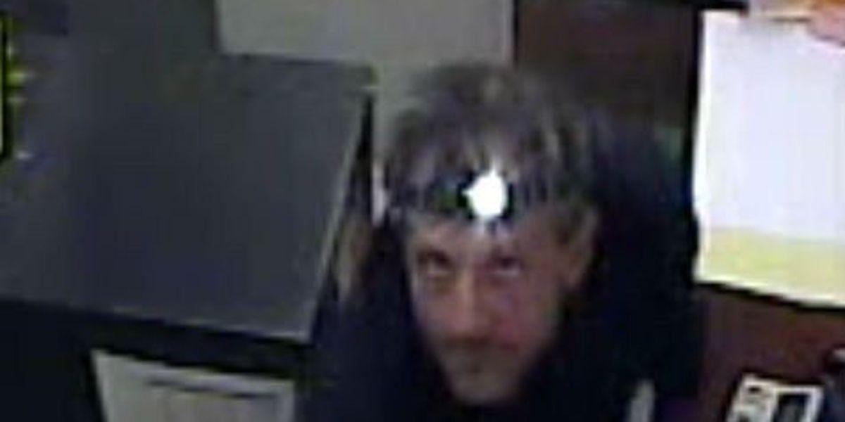 Police release photos of burglar who cut his way into Big Lots cash room