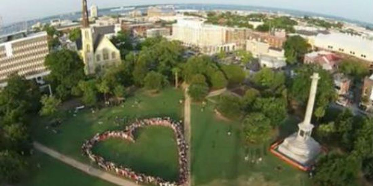 Hundreds form heart-shaped tribute for shooting victims at Marion Square